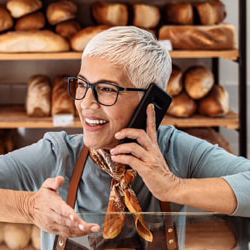 Female with glasses talking on phone