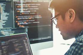 Man looking at software code
