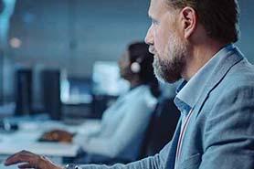Person looking at computer code detecting ransomware