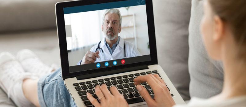 Doctor doing Facetime on laptop