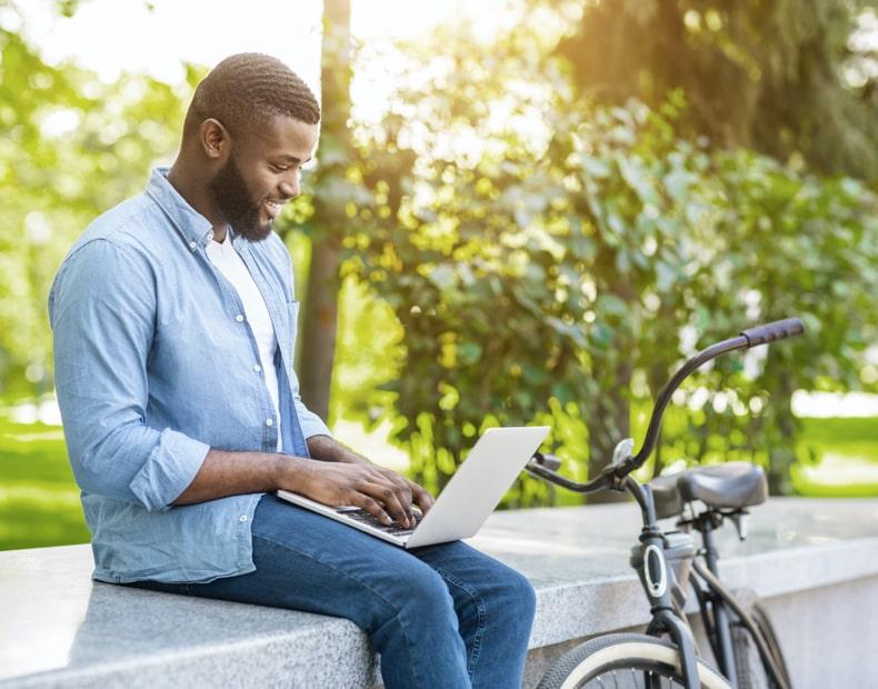 Man working outside on laptop