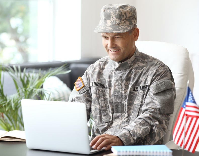 Military personal working on laptop
