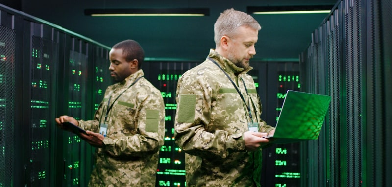 Military personnel working in data center