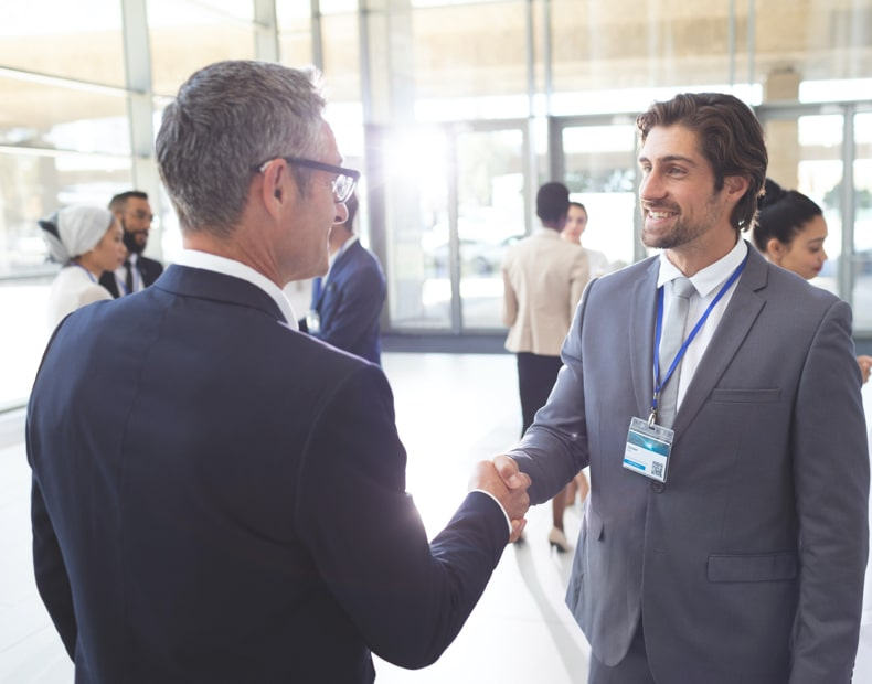 Two people shaking hands in an event