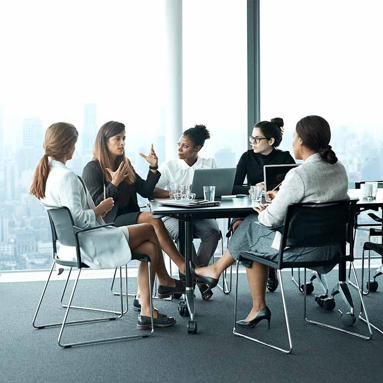 Iris image team of women sitting around table