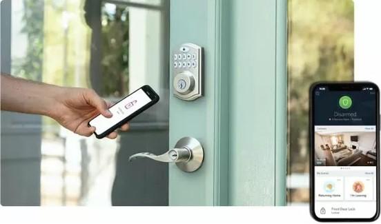Person opens door using Cox Smart Lock and the Cox Homelife app