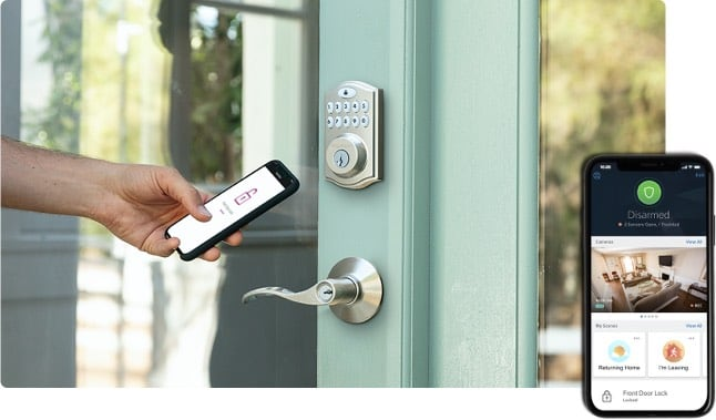 homelife security and automation hand holding mobile phone in front of door to unlock door and inset of mobile with homelife app on screen.jpg