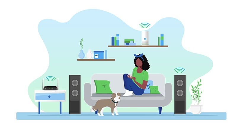 Lady sitting on couch on device between speakers