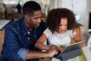 dad teaching daughter